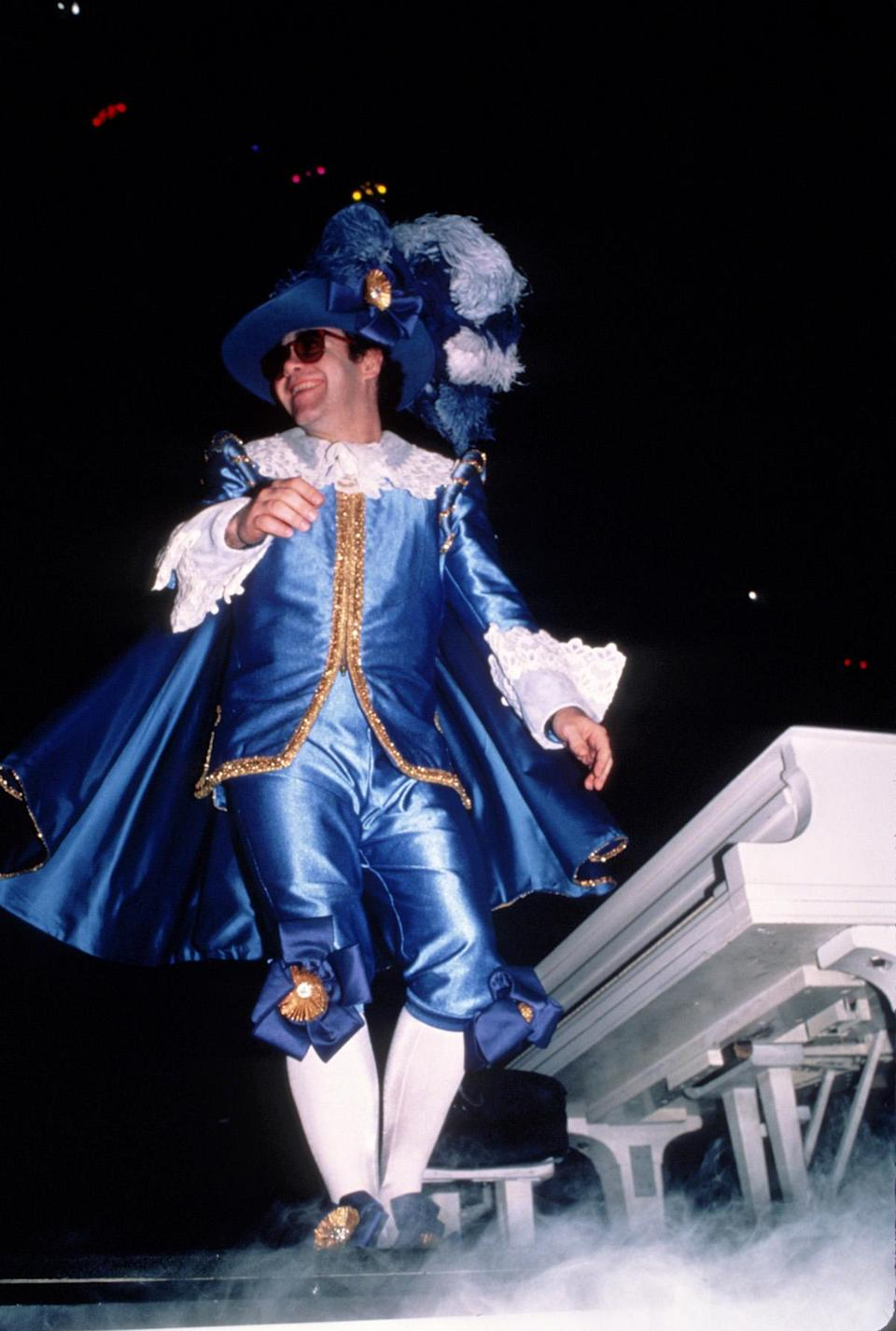 <p>Elton John looking royal in royal blue in 1982. (Photo: Getty Images) </p>