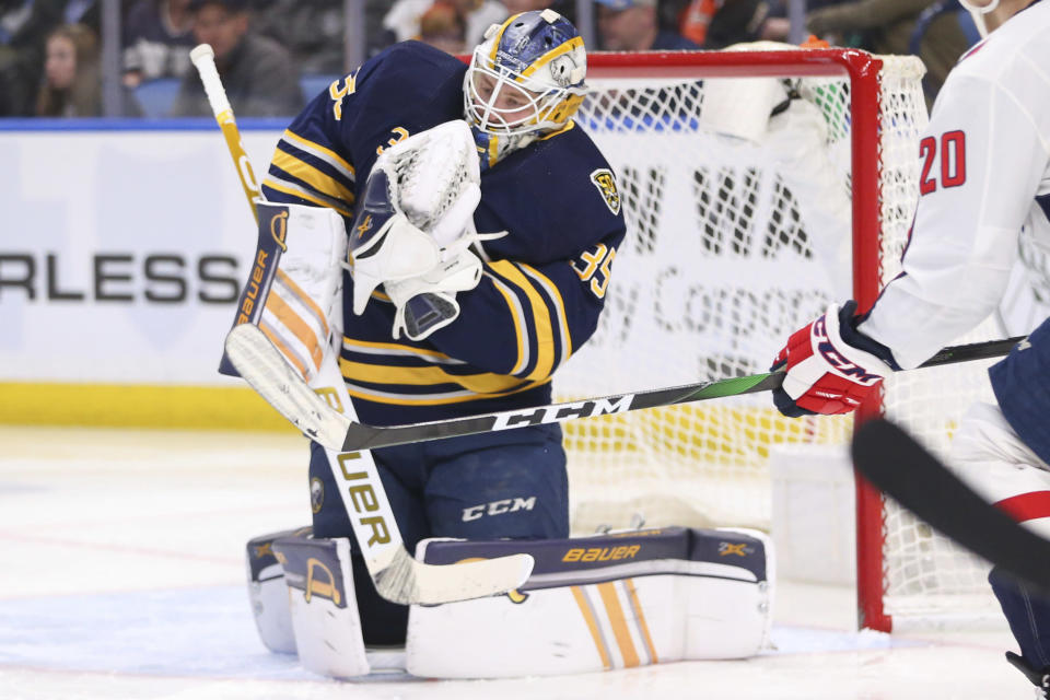 Buffalo Sabres goalie Linus Ullamark (35) makes a save during the second period of an NHL hockey game against the Washington Capitals, Monday, March 9, 2020, in Buffalo, N.Y. (AP Photo/Jeffrey T. Barnes)