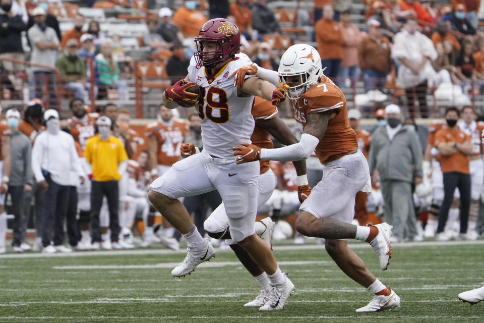 Iowa State tight end Charlie Kolar required multiple Texas defenders to drag him down. (AP Photo/Eric Gay)