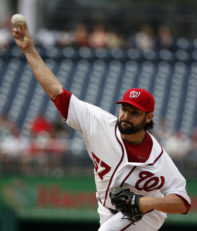 Washington Nationals starting pitcher Tanner Roark (57) throws during the first inning of a baseball game against the Cincinnati Reds at Nationals Park Wednesday, May 21, 2014, in Washington. (AP Photo/Alex Brandon)