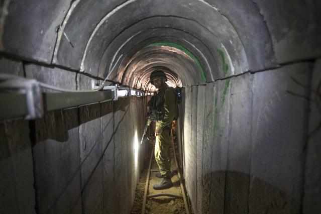 An Israeli army officer walks during an army organised tour for journalists in a tunnel said to be used by Palestinian militants for cross-border attacks, July 25, 2014. U.S. Secretary of State John Kerry pressed regional leaders to nail down a Gaza ceasefire on Friday as the civilian death toll soared, and further violence flared between Israelis and Palestinians in the occupied West Bank and Jerusalem. REUTERS/Jack Guez/Pool (CIVIL UNREST MILITARY POLITICS CONFLICT)