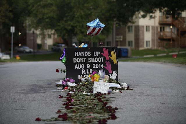 A makeshift memorial in Ferguson, Mo., for Michael Brown, who was fatally shot by Police Officer Darren Wilson on Aug. 9, 2014. (Photo: Joshua Lott/AFP/Getty Images)