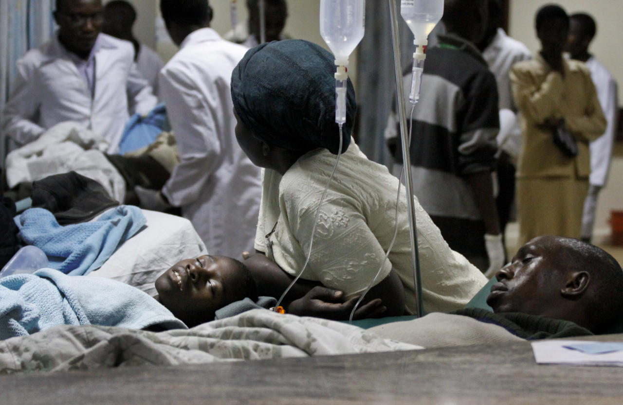 People injured in a grenade attack at a downtown bus station are treated at Kenyatta Hospital in Nairobi, Kenya Saturday, March 10, 2012. Explosions at one of the Kenyan capital's main bus stations killed and wounded a number of people Saturday, officials said, in an attack blamed on sympathizers of Somalia's al-Qaida-linked insurgency. (AP Photo/Khalil Senosi)
