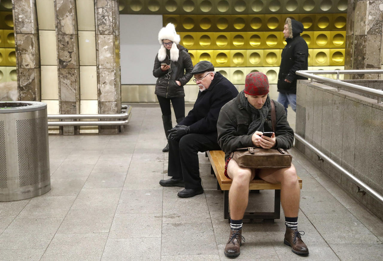 <p>A passenger not wearing pants uses his cellphone while taking part in the No Pants Subway Ride in Prague on Jan. 8. The No Pants Subway Ride began in 2002 in New York as a stunt and has taken place in cities around the world since then. (Petr David Josek/AP) </p>