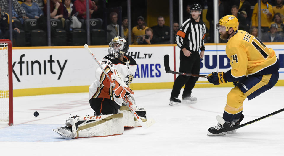 Nashville Predators defenseman Mattias Ekholm (14), of Sweden, scores a goal against Anaheim Ducks goaltender John Gibson (36) during the second period of an NHL hockey game Tuesday, Oct. 22, 2019, in Nashville, Tenn. (AP Photo/Mark Zaleski)