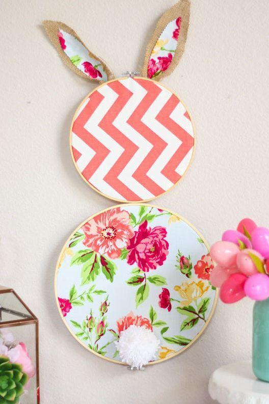 """<p>Make some Easter wall decor with two embroidery hoops and colorful fabric. Don't forgot a cotton ball for a fluffy tail.</p><p><strong>Get the tutorial at <a href=""""https://designimprovised.com/2018/03/diy-embroidery-hoop-easter-bunny.html"""" rel=""""nofollow noopener"""" target=""""_blank"""" data-ylk=""""slk:Design Improvised"""" class=""""link rapid-noclick-resp"""">Design Improvised</a>.</strong></p><p><strong><a class=""""link rapid-noclick-resp"""" href=""""https://www.amazon.com/Similane-Pieces-Embroidery-Bamboo-Circle/dp/B07CV96FQV?tag=syn-yahoo-20&ascsubtag=%5Bartid%7C10050.g.1111%5Bsrc%7Cyahoo-us"""" rel=""""nofollow noopener"""" target=""""_blank"""" data-ylk=""""slk:SHOP EMBROIDERY HOOPS"""">SHOP EMBROIDERY HOOPS</a><br></strong></p>"""