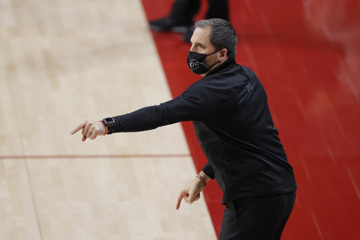 Iowa State head coach Steve Prohm directs his team against Jackson State during the first half of an NCAA college basketball game, Sunday, Dec. 20, 2020, in Ames, Iowa. (AP Photo/Matthew Putney)