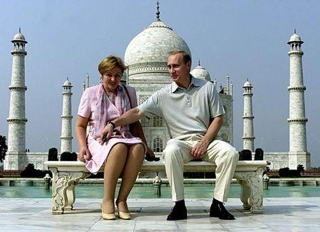 FILE PHOTO: Russian President Vladimir Putin and his wife Lyudmila sit in front of the Taj Mahal while touring city of Agra, October 4, 2000. REUTERS/Pawel Kopczynski/File Photo