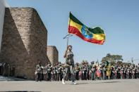 A woman carries an Ethiopian national flag in ceremonies at the prime minister's compound in Addis on Wednesday to honour the armed forces