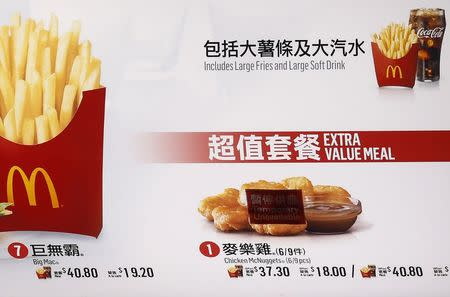 """A """"Temporary Unavailable"""" sticker is placed on a picture of chicken nuggets on the menu at a McDonald's restaurant in Hong Kong"""