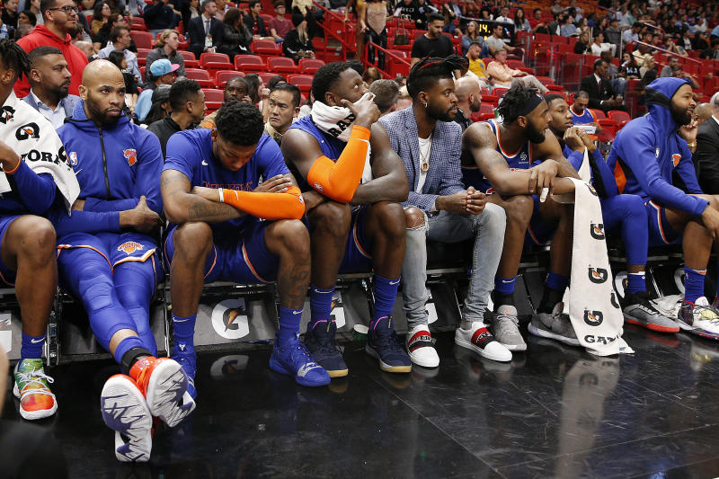 MIAMI, FLORIDA - DECEMBER 20: The New York Knicks bench reacts against the Miami Heat during the second half at American Airlines Arena on December 20, 2019 in Miami, Florida. NOTE TO USER: User expressly acknowledges and agrees that, by downloading and/or using this photograph, user is consenting to the terms and conditions of the Getty Images License Agreement. (Photo by Michael Reaves/Getty Images)