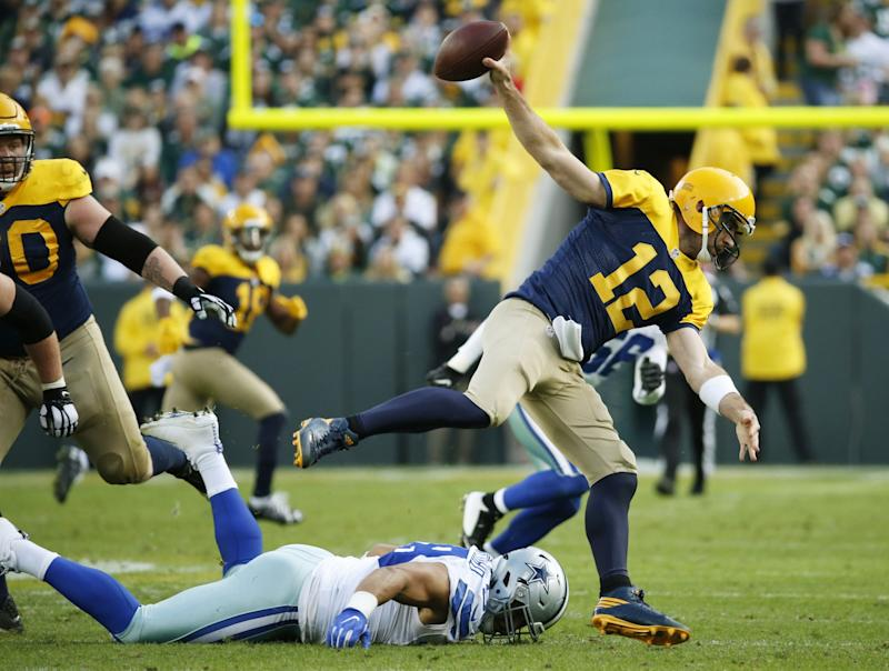 The Green Bay Packers and quarterback Aaron Rodgers, 12, have been stumbling offensively. (AP)