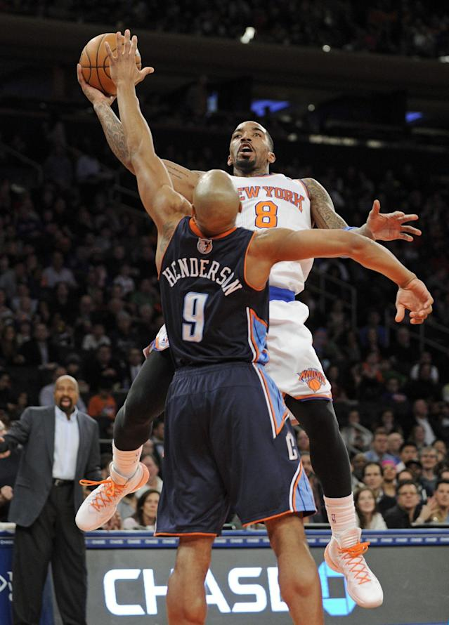 New York Knicks' J.R. Smith, right, puts up a shot over Charlotte Bobcats' Gerald Henderson during the second quarter of an NBA basketball game, Friday, Jan. 24, 2014, at Madison Square Garden in New York. The Knicks won 125-96. (AP Photo/Bill Kostroun)
