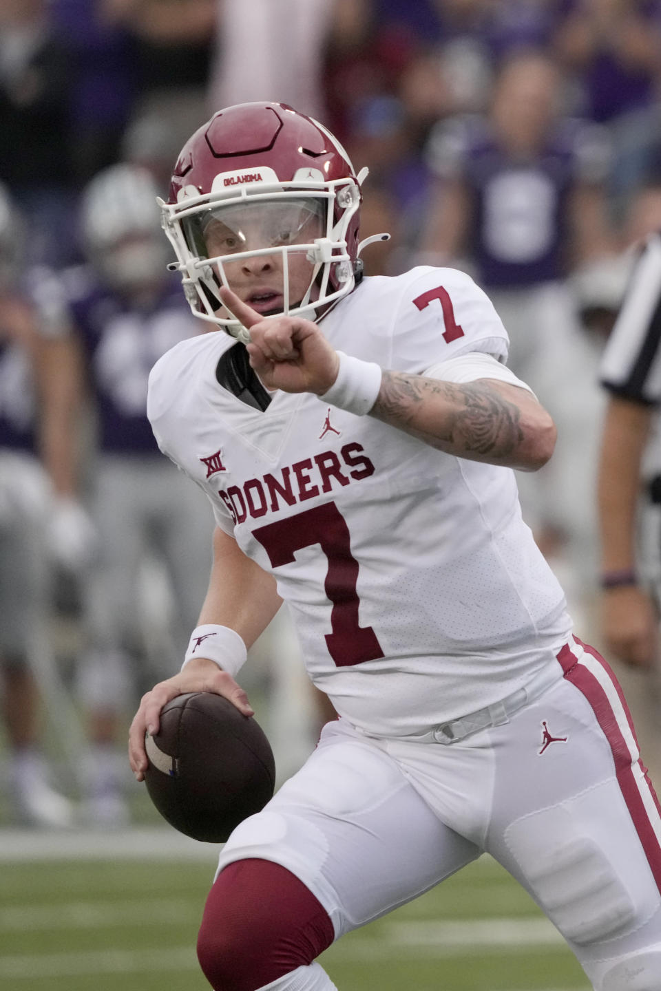 Oklahoma quarterback Spencer Rattler (7) directs his receivers during the second half of an NCAA college football game against Kansas State in Manhattan, Kan., Saturday, Oct. 2 2021. (AP Photo/Orlin Wagner)
