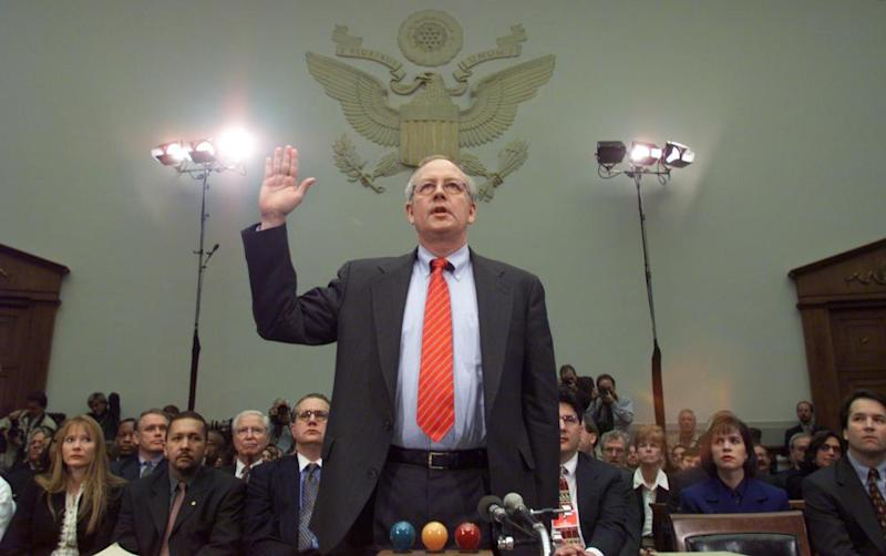 Kenneth Starr is sworn in on Capitol Hill Thursday in 1998, prior to testifying before the House judiciary committee's impeachment hearing against Bill Clinton.