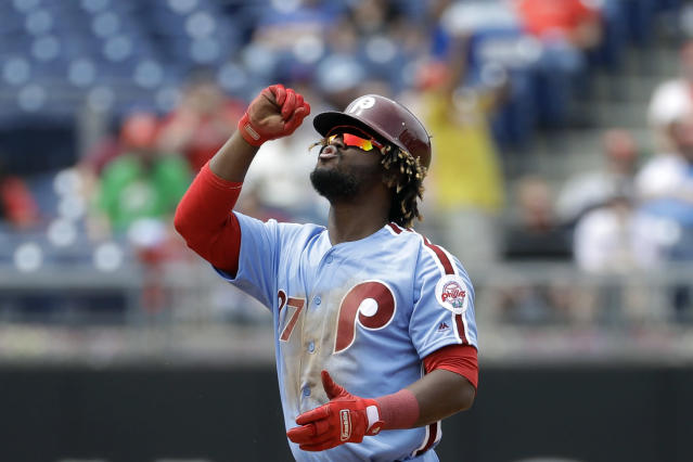 Philadelphia Phillies' Odubel Herrera reacts after hitting a double off San Francisco Giants starting pitcher Ty Blach during the fourth inning of a baseball game, Thursday, May 10, 2018, in Philadelphia. (AP Photo/Matt Slocum)