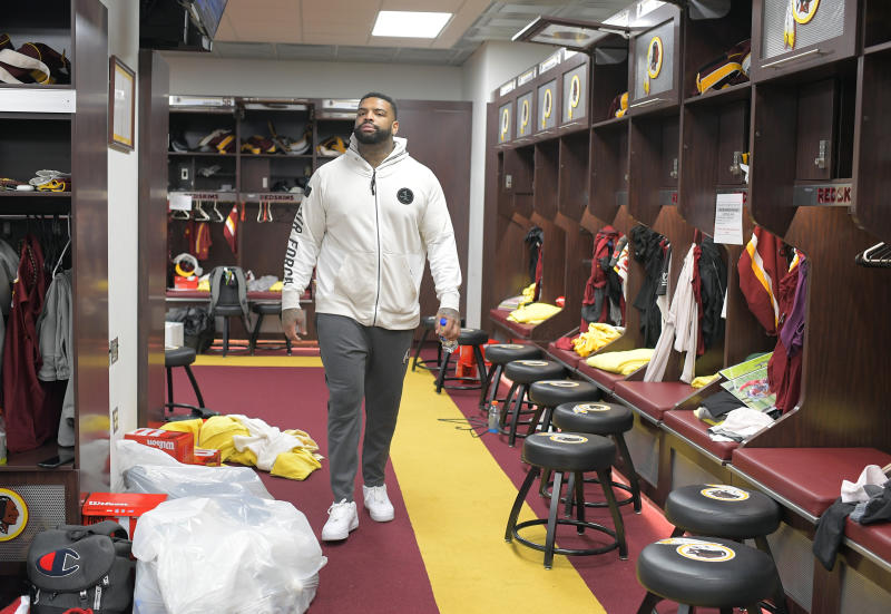 ASHBURN, VA- DECEMBER 31: Washington Redskins offensive tackle Trent Williams (71) walks through the locker room as the Redskins clean out lockers after last game of season at Redskins Park in Ashburn, VA on December 31, 2018. (Photo by John McDonnell/The Washington Post via Getty Images)