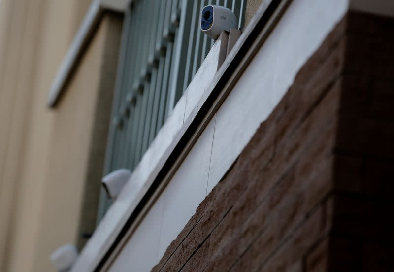 Three wireless security cameras installed above the entrance of the Tokyo residence of former Nissan chairman Carlos Ghosn are pictured, while prosecutors raid the house, in Tokyo