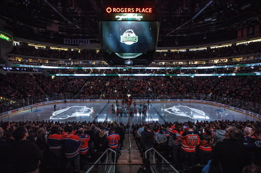 The Vancouver Canucks and the Edmonton Oilers pay tribute to the Humboldt Broncos in Edmonton, Alberta, Saturday, April 7, 2018. (Jason Franson/The Canadian Press via AP)