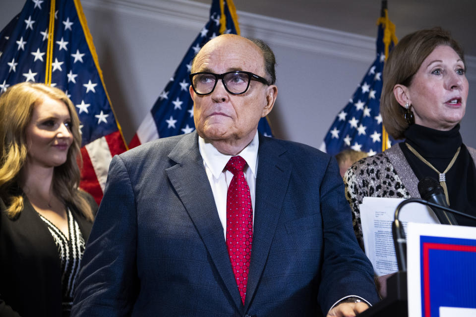 UNITED STATES - NOVEMBER 19: Rudolph Giuliani, attorney for President Donald Trump, conducts a news conference at the Republican National Committee on lawsuits regarding the outcome of the 2020 presidential election on Thursday, November 19, 2020. Trump attorneys Jenna Ellis, left,and Sydney Powell, also appear. (Photo By Tom Williams/CQ-Roll Call, Inc via Getty Images)