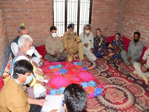 J-K LG Manoj Sinha visited Rajouri district's Tarkassi village and reached out to the families of three youth who were killed in Shopian in July.