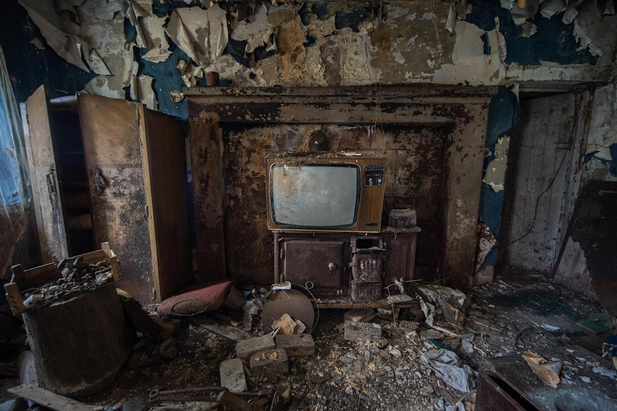 A television sits in a pile of rubble inside an abandoned home in Northern Ireland on March 12, 2018. (Photo: Unseen Decay/Mercury Press/Caters News)