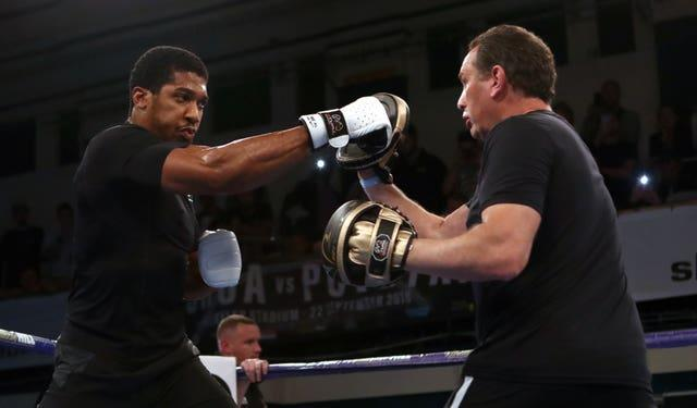 Rob McCracken, right, should be in Joshua's corner if a fight against Fury goes ahead on August 14 (John Walton/PA)