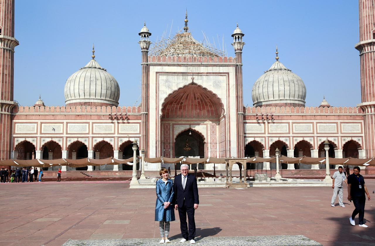 Germany's President Frank-Walter Steinmeier and his wife Elke Buedenbender pose for a photograph during their visit to the Jama Masjid (Grand Mosque) in the old quarters of Delhi, India, March 23, 2018. REUTERS/Cathal McNaughton