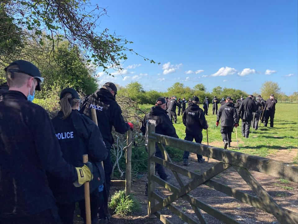 Police officers searching a field off Ratling Road in Aylesham, Kent, as the murder investigation into the death of PCSO Julia James continues (Michael Drummond/PA)
