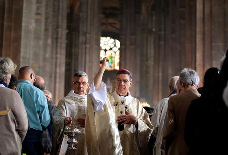 Archbishop of Paris Michel Aupetit attends Easter Sunday Mass at Saint-Eustache, days after a massive fire devastated large parts of the structure of the gothic Notre-Dame Cathedral, in Paris, France, April 21, 2019.  REUTERS/Gonzalo Fuentes