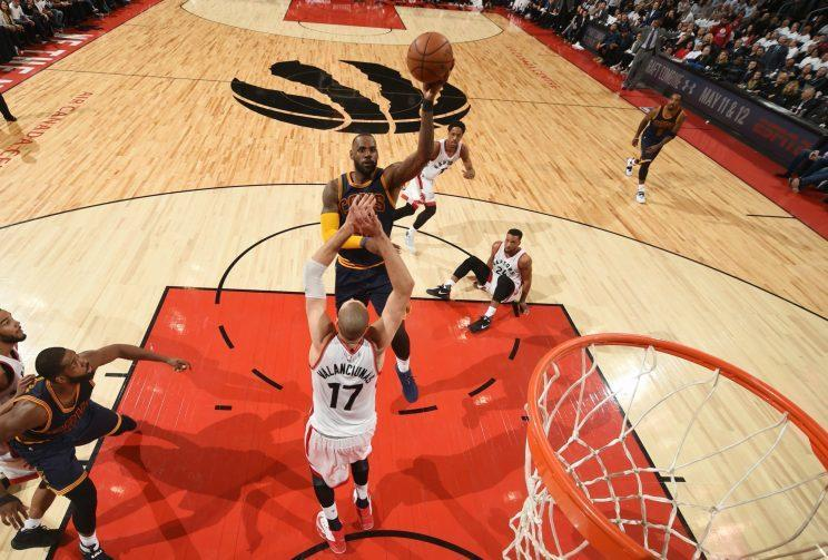 LeBron takes one of a few left-handed floaters against the Raptors. (Getty)