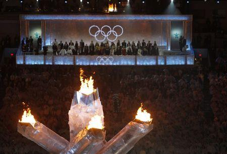 Numerous officials sit on an elevated stand near the Olympic flames as they attend the closing ceremony of the Vancouver 2010 Winter Olympics, February 28, 2010. REUTERS/Gary Hershorn