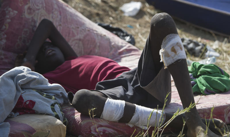A displaced boy rests after seeking refuge at the compound of the United Nations Mission in South Sudan (UNMISS), in Juba, South Sudan Thursday, Dec. 19, 2013. South Sudan, the world's newest country, is threatened by rapidly escalating ethnic violence, as officials said Thursday that the government no longer controls the capital of its largest and most populous state. (AP Photo)