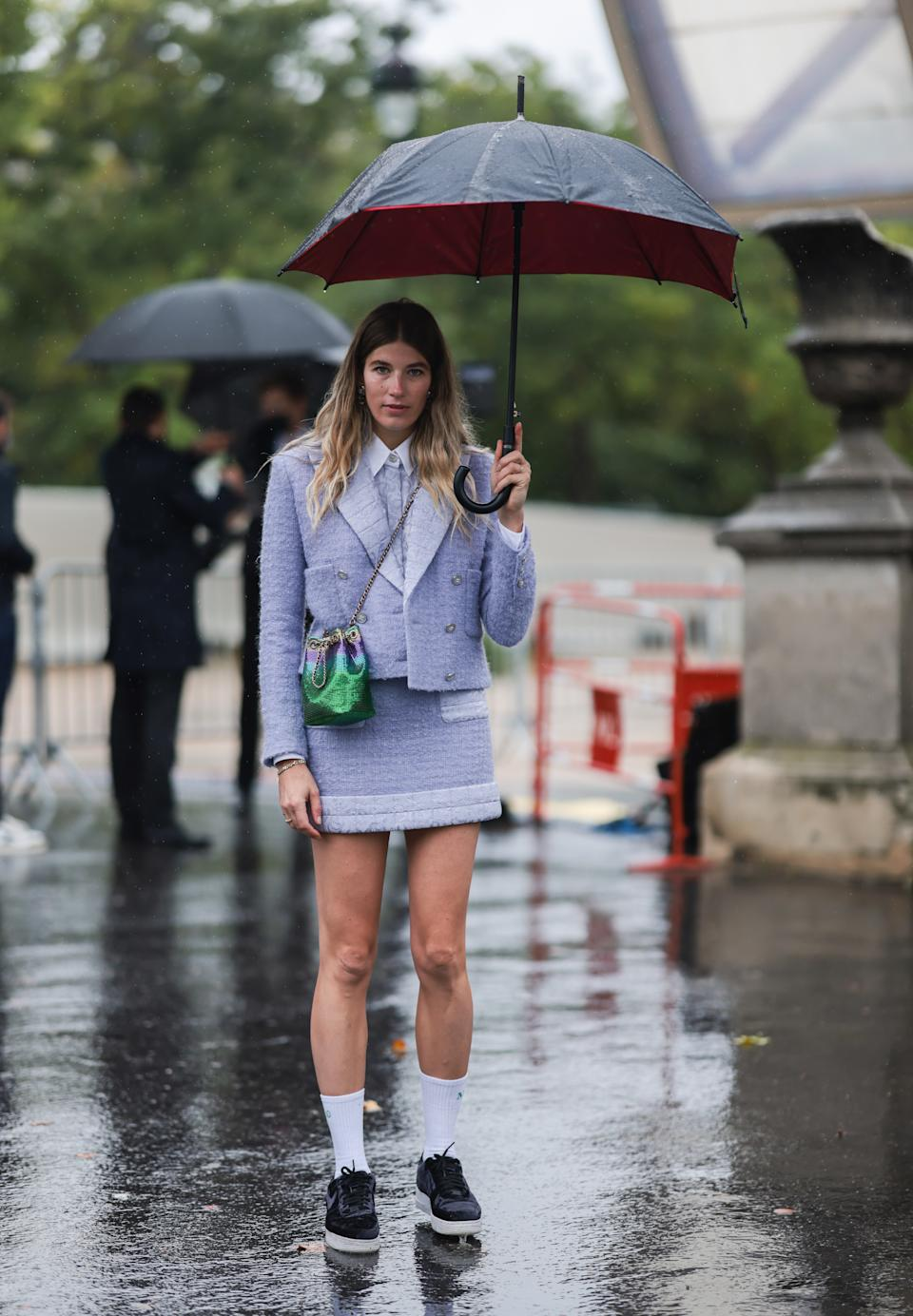 PARIS, FRANCE - OCTOBER 05: Veronika Heilbrunner wearing a blue blazer, a blouse and a skirt, a green bag and Nike sneaker on outside Chanel October 05, 2021 in Paris, France. (Photo by Jeremy Moeller/Getty Images)