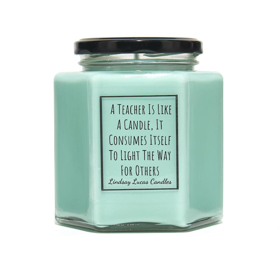 """<p><strong>Lindsay Lucas Candles</strong></p><p>etsy.com</p><p><strong>$12.24</strong></p><p><a href=""""https://go.redirectingat.com?id=74968X1596630&url=https%3A%2F%2Fwww.etsy.com%2Flisting%2F231072280%2Fthank-you-teacher-scented-candle-gift-a&sref=https%3A%2F%2Fwww.goodhousekeeping.com%2Fholidays%2Fgift-ideas%2Fg1432%2Fteacher-gifts%2F"""" rel=""""nofollow noopener"""" target=""""_blank"""" data-ylk=""""slk:Shop Now"""" class=""""link rapid-noclick-resp"""">Shop Now</a></p><p>It'd be hard for any teacher not to be moved by the quote on this candle. As an added bonus, there's a selection of more than 50 fragrances to choose from.</p>"""