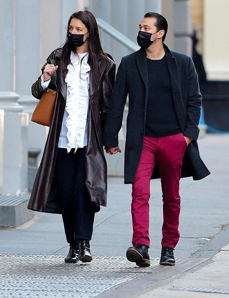 <p>Katie Holmes and boyfriend Emilio Vitolo Jr. hold hands as they go shopping in N.Y.C. on Thursday. </p>