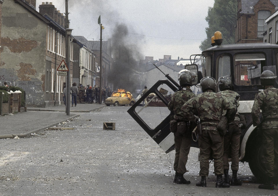 """FILE - In this May 5, 1981 file photo British troops, in foreground, clash with demonstrators in a Catholic dominated area of Belfast, Northern Ireland. The chaotic scenes during a week of violence on the streets of Northern Ireland have stirred memories of decades of Catholic-Protestant conflict, known as """"The Troubles."""" A 1998 peace deal ended large-scale violence but did not resolve Northern Ireland's deep-rooted tensions. (AP Photo, File)"""