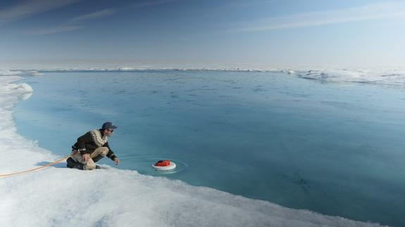 UCLA's Laurence Smith deployed this autonomous drifter in a meltwater river on the surface of the Greenland ice sheet in July 2015 as part of an effort to understand the causes of sea level rise around the globe.