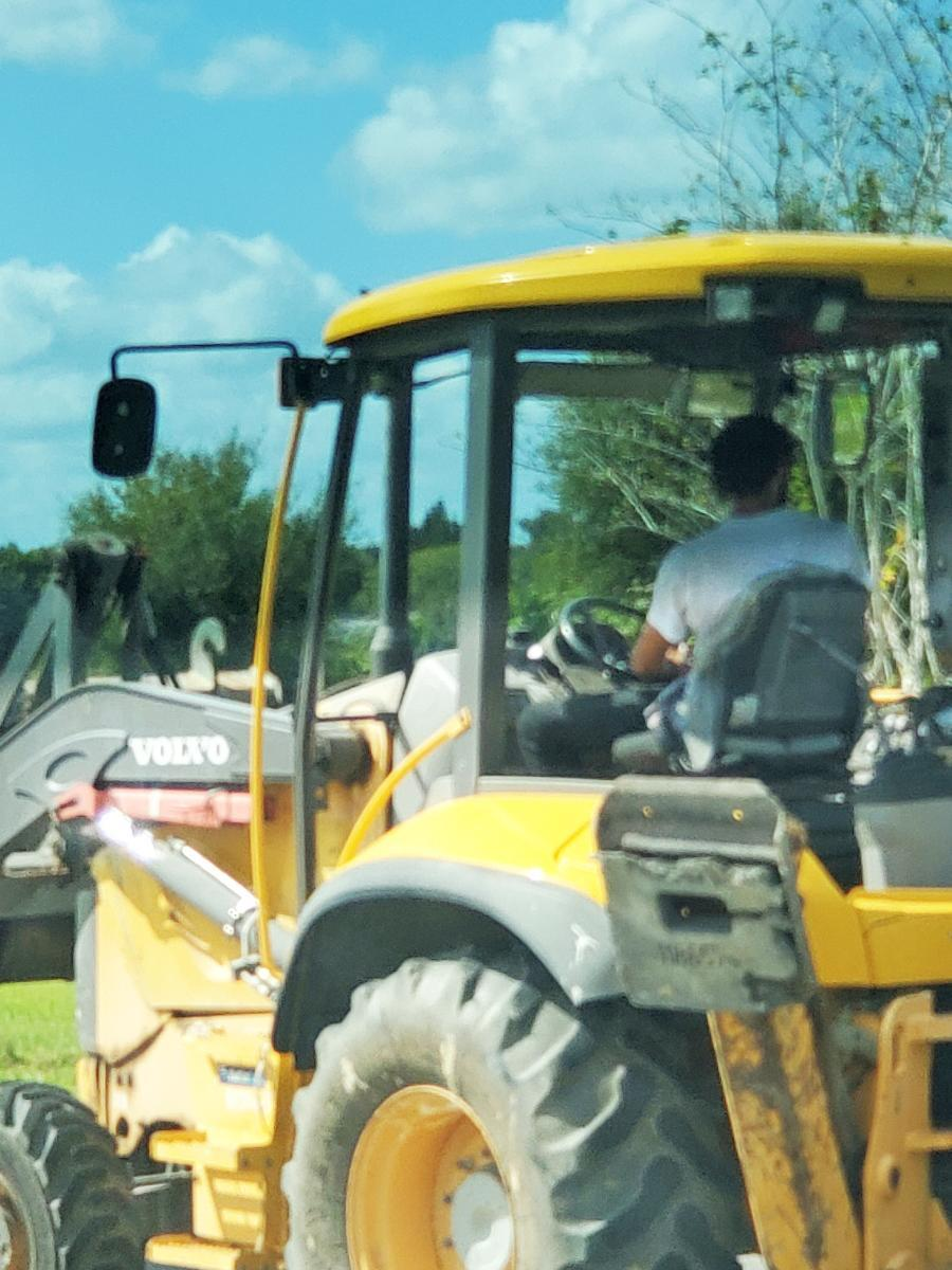 A man allegedly used a bulldozer to rip Biden campaign signs in Haines City, Fla. (Courtesy Cornelius Marion)