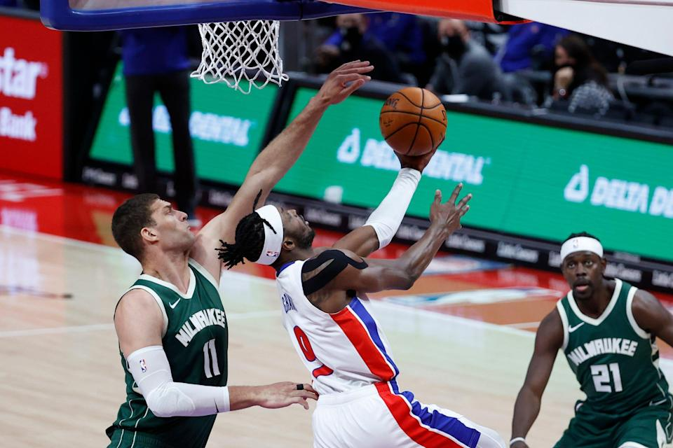 Pistons forward Jerami Grant goes to the basket while defended by Bucks center Brook Lopez in the first half on Wednesday, Jan. 13, 2021, at Little Caesars Arena.