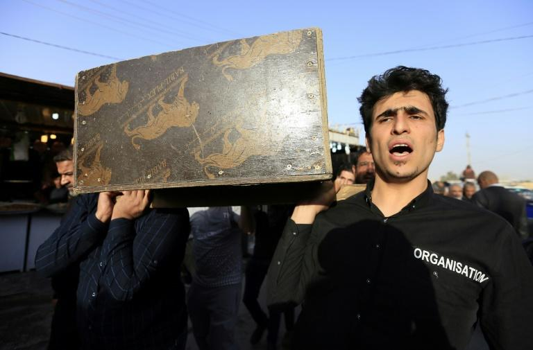 Iraqis carry the coffin of a victim of the Baghdad blasts during a funeral in the holy city of Najaf on January 15, 2018