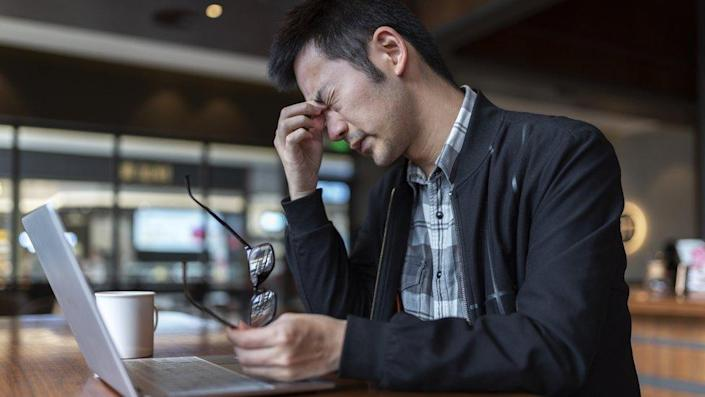 Stressed man working with laptop