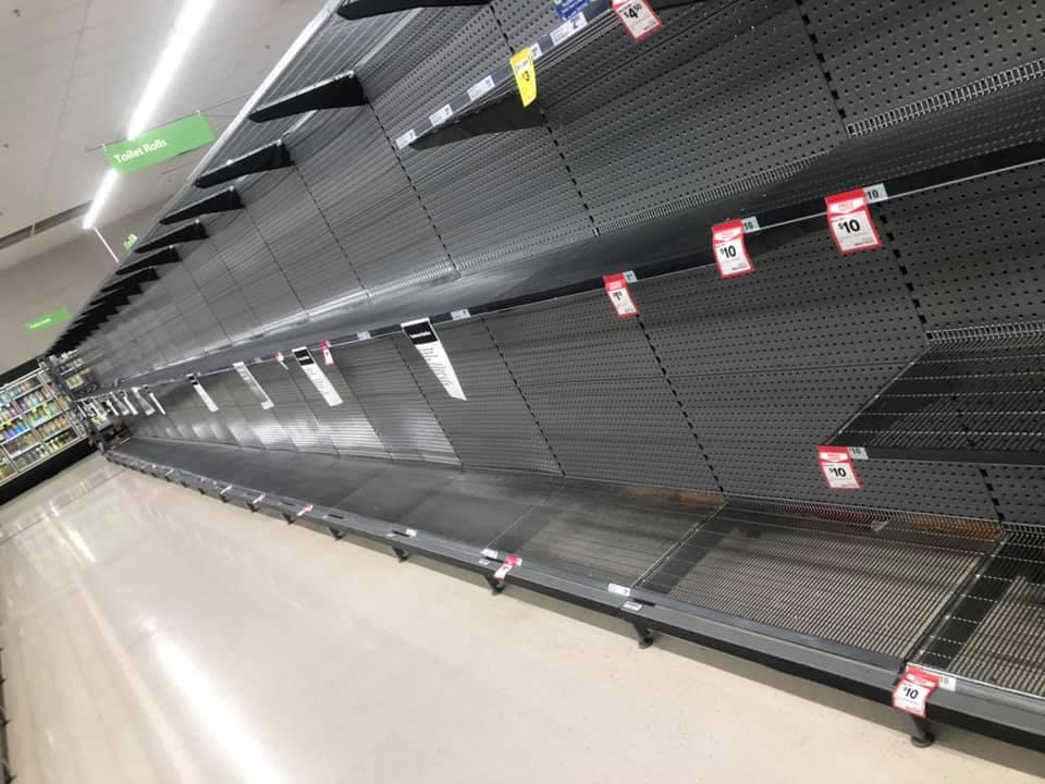 Woolworths shelves can be seen empty of toilet paper.
