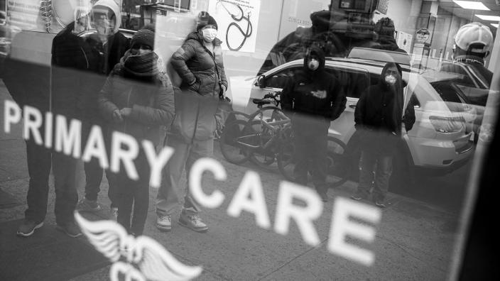 Patients wait inside an urgent care pharmacy while wearing personal protective equipment, Wednesday, March 25, 2020, in the Queens borough of New York. Gov. (John Minchillo/AP)