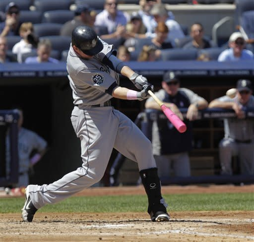 Seattle Mariners' Justin Smoak hits a two-run home run during the fourth inning of a baseball game against the New York Yankees at Yankee Stadium in New York, Sunday, May 13, 2012. (AP Photo/Seth Wenig)