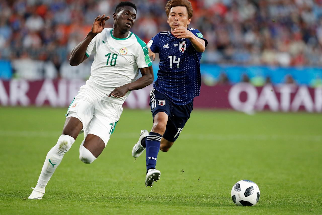 Soccer Football - World Cup - Group H - Japan vs Senegal - Ekaterinburg Arena, Yekaterinburg, Russia - June 24, 2018   Senegal's M'Baye Niang in action with Japan's Takashi Inui                             REUTERS/Carlos Garcia Rawlins