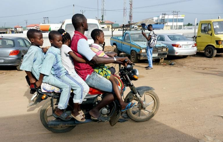 Room for one more? A traditional motorcycle taxi on Lagos roads -- overladen and not a crash helmet in sight