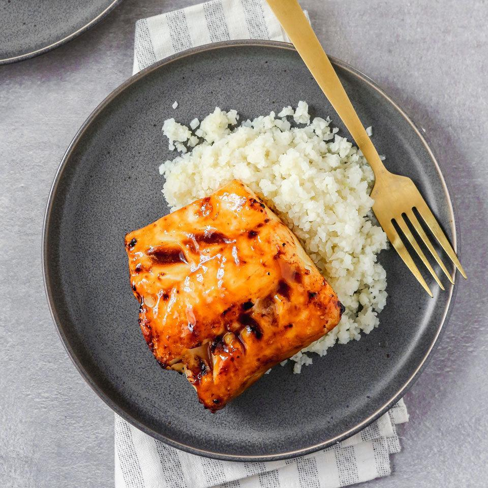 "<p>This healthy fish recipe comes together fast with just three ingredients you can always have on hand in your freezer and fridge. Store-bought teriyaki glaze makes a great marinade for cod that doubles as a sauce for the cauliflower rice. <a href=""http://www.eatingwell.com/recipe/264168/teriyaki-glazed-cod-with-cauliflower-rice/"" rel=""nofollow noopener"" target=""_blank"" data-ylk=""slk:View recipe"" class=""link rapid-noclick-resp""> View recipe </a></p>"