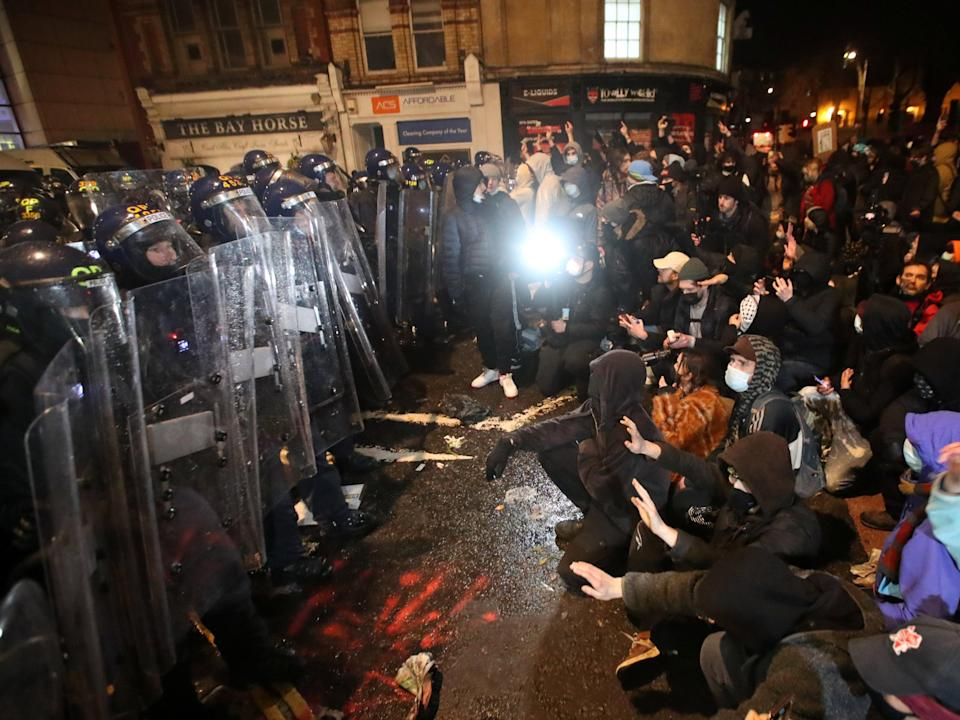 <p>Riot police could be seen pushing people to the ground with their shields in videos posted on social media</p> (REUTERS)