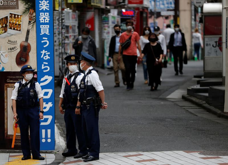 Police officers wearing protective face masks are seen as the spread of the coronavirus disease (COVID-19) continues, in Tokyo